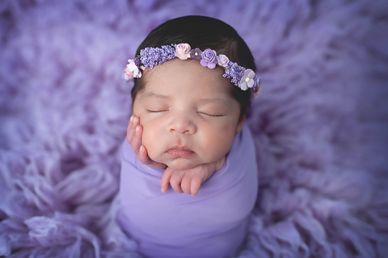 Newborn Photography, baby girl wrapped in a purple blanket