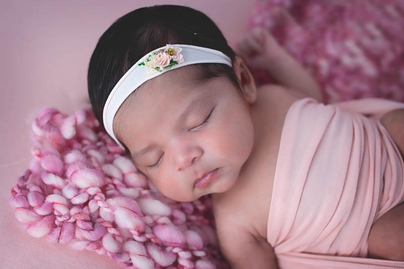 Newborn Photography, baby asleep on pink blanket