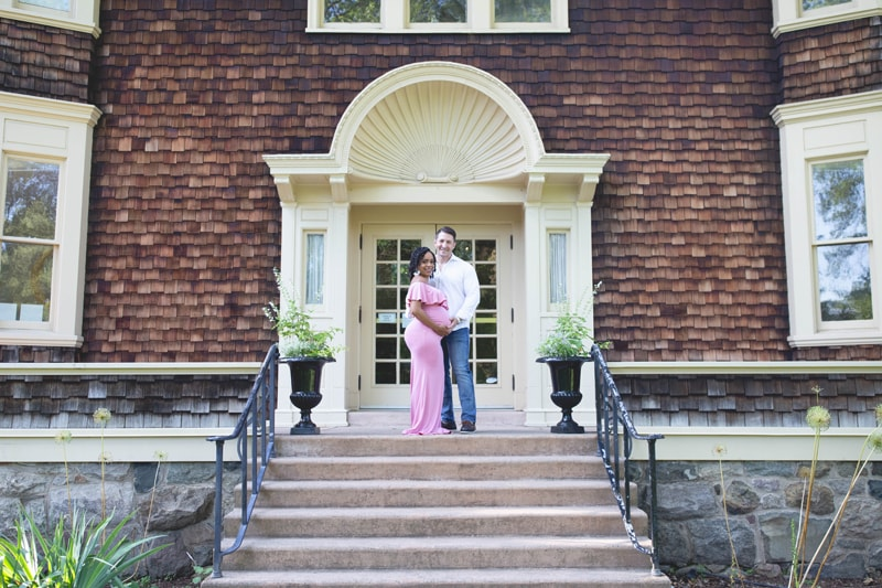 Maternity Photography, couple standing at the top of their stairs