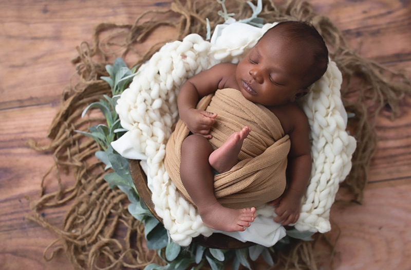 Newborn Photography, baby wrapped in a tan blanket