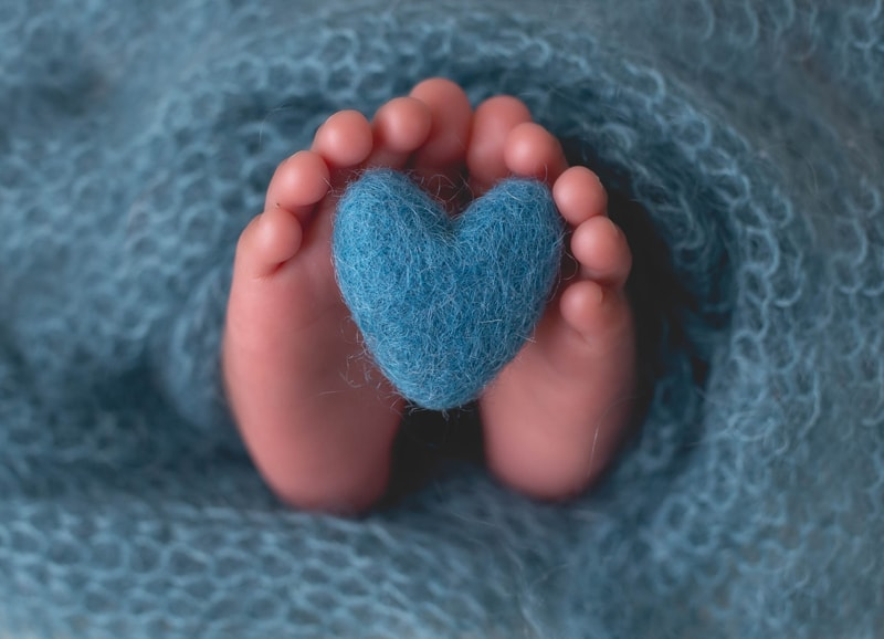 Newborn Photography, close up of baby's feet with blue heart
