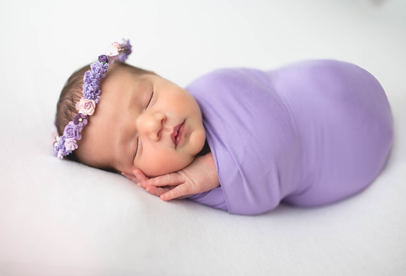 Newborn Photography, baby wrapped in lavender blanket