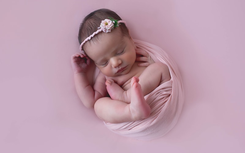 Newborn Photography, baby wrapped in pink