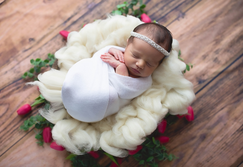 Newborn Photography, baby wrapped in white in baskete