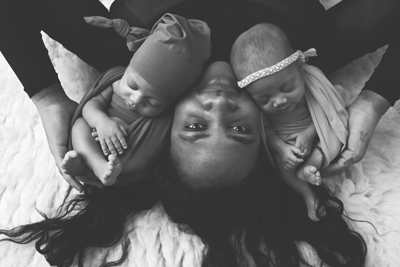 Newborn Photography, black and white image of mother with twin babies