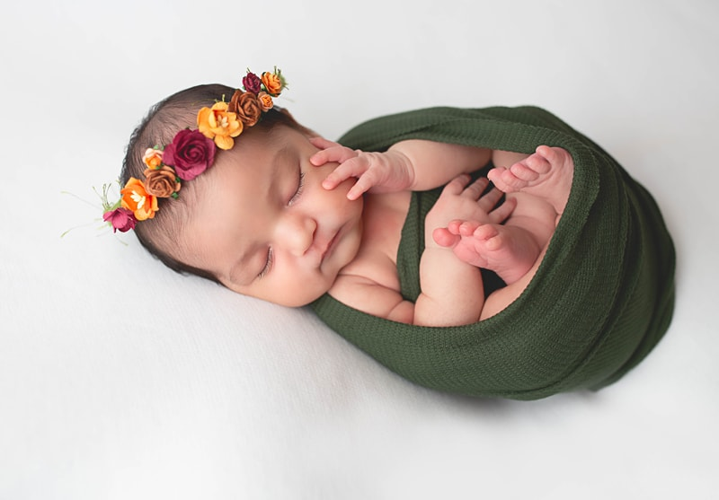 Newborn Photography, baby wrapped in green