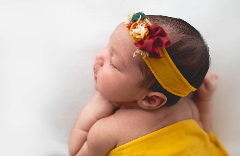 Newborn Photography, baby wrapped in yellow with headband