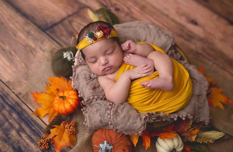 Newborn Photography, baby wrapped in yellow