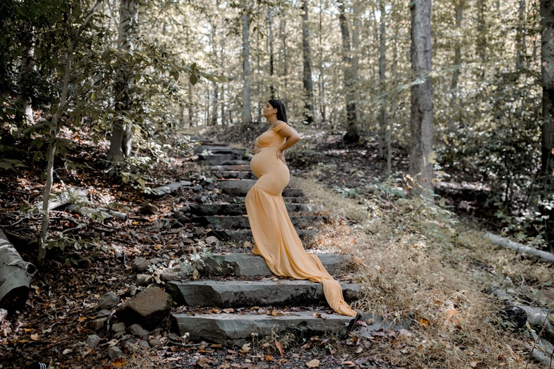 Maternity Photography, woman in yellow standing on steps