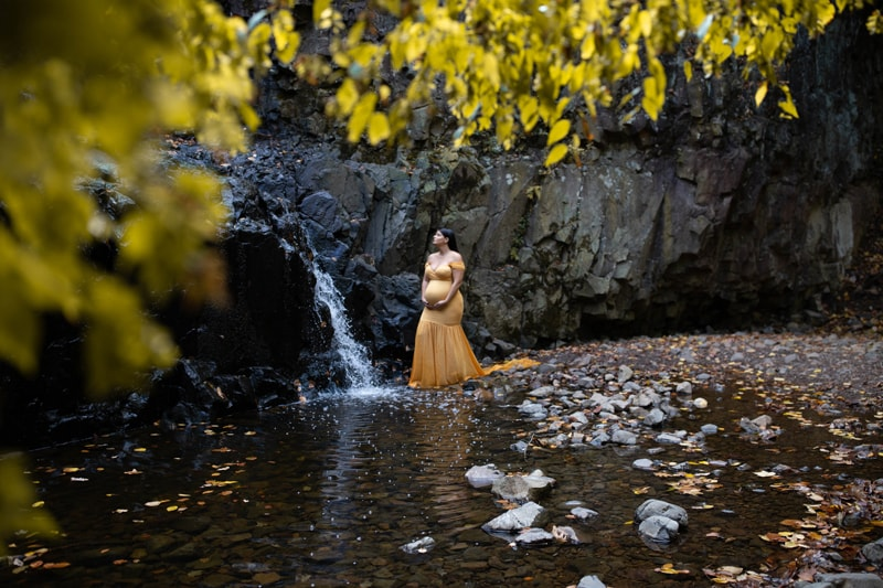 Maternity Photography, woman in yellow dress standing by the water