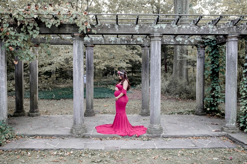 Maternity Photography, woman standing under an old archway