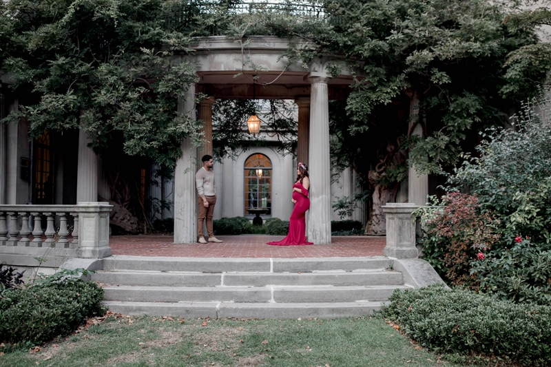 Maternity Photography, couple leaning against columns, looking at eachother
