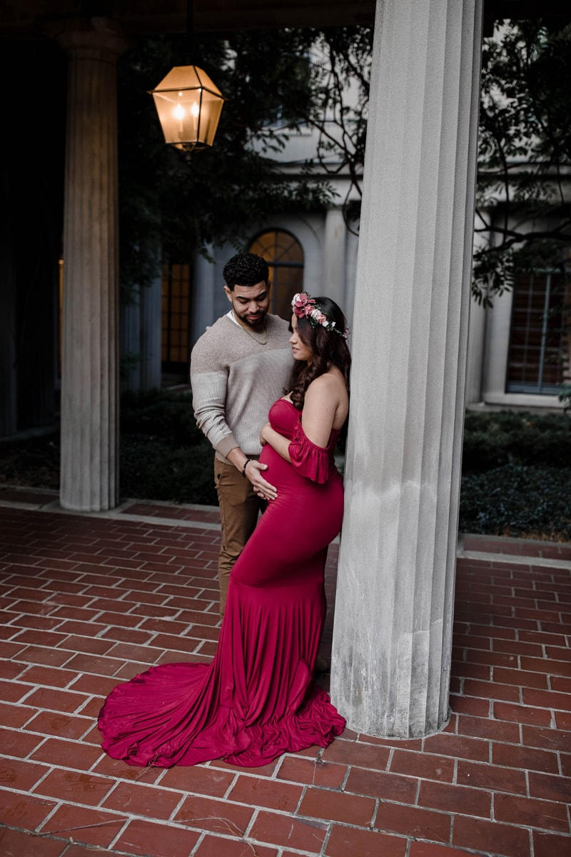 Maternity Photography, couple standing against column