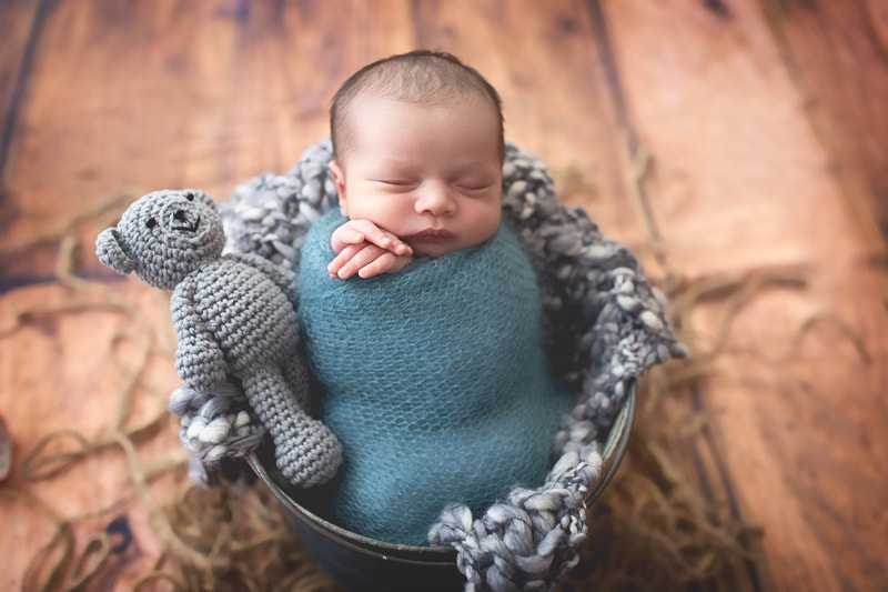 Newborn Photography, baby wrapped in blue blanket