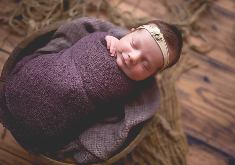 Newborn Photography, baby wrapped in purple blanket