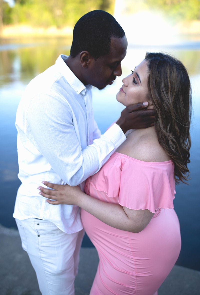 Maternity Photography, man going in for a kiss with woman